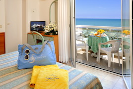 Balcony, Beach and sea as seen from bed....